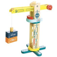 Rotary Docker Crane equipped with a crank and a magnetic tip to move containers easily. This Wooden Docker Crane is part of the Vilacity range. 28 x 34 x 18 cm. Moving Containers, Wooden Containers, Wooden Toy Barn, Wooden Toys, Kids Moves, Gift Card Shop, Cargo Container, Children's Boutique, Toy Trucks