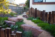 Applying sleepers vertical and at different sizes dramatically improves the effect in a natural bush style garden. Well positioned large rocks adds the next level of charm. Critic by John Dodd. Landscaping With Rocks, Backyard Landscaping, Water Garden, Lawn And Garden, Garden Path, Garden Bed, Back Gardens, Outdoor Gardens, Landscape Design
