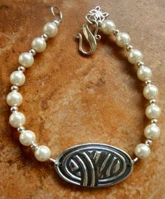 Pretty metal clay and pearl bracelet.
