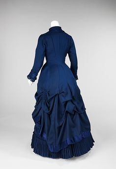 Blue wool dress with silk satin trim and mother-of-pearl buttons (back), American, 1881.