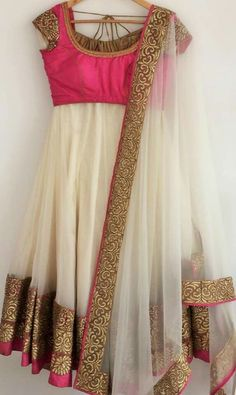 Off white and hot pink anarkali with gold border. Geethika Kanumilli.