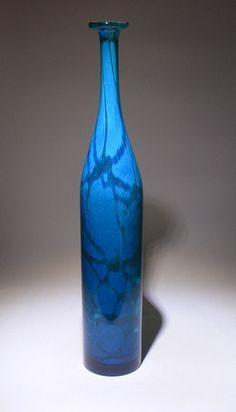 An attenuated blue bottle. A Mdina glass classic.
