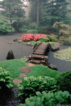 Japanese garden with island and bridge.