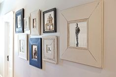 super fun gallery wall-looks like these frames, if not collected, were made from scraps and painted different colors for an eclectic look.  Nice!