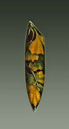 Enamel and gold brooch, by Larissa Podgoretz. I love the use of enamel to show the depth of the ginkgo leaf.