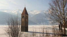 The Campanile di Curon church in northern Ital is the final reminder of a town drowned by three rivers after World War II.  According to Sla...