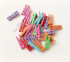 Set of 30 Colorful Small Pegs-Clothespins- Orange, Purple, Green, Teal, Hot Pink, Red Clothespins - Set of 30pcs by StudioIdea on Etsy Favor Bags, Gift Bags, Colour List, Teal, Purple, Clothespins, I Shop, Craft Supplies, Hot Pink