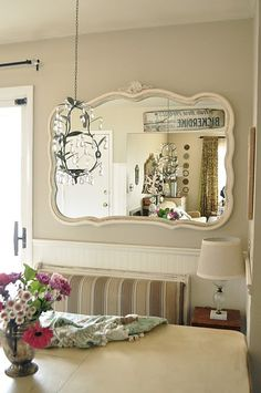 Like this idea for a breakfast nook.  Like the little table and lamp in the corner and the antique mirror, too.