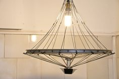 'Trompo' ('Humming-top') by Ramiro Sobral. Creating lamps recycling old bicycle…