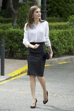 Queen Letizia, 44, added an edgy touch to her outfit today with a figure-hugging leather pencil skirt for an event in Madrid