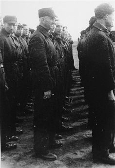Jewish police in Westerbork stand in formation (July 1, 1942-April 1943)