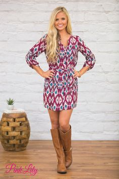 This gorgeous dress will bring an extra burst of fall colors to your wardrobe! Featuring a beautiful print in aqua, plum, black, and cream, it's such a stunner!