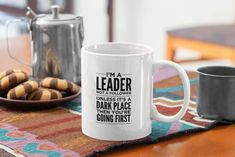 """Love this """"I'm a Leader Not a Follower Unless It's a Dark Place Then You're Going First"""" funny mug?  We do too :)  Its the perfect cute gift idea for moms, best friends, co-workers, women or even yourself...    #funnymug #giftideas #funnycoffeemug #giftideasforfriends #KatieMcGrathDesigns Funny Coffee Mugs, Coffee Humor, Funny Mugs, Dog Lover Gifts, Gift For Lover, Funny Gifts For Dad, Mugs For Men, That Way, Acceptance"""