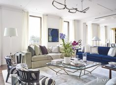 Thanks to a reimagined floor plan that opens to the skyline views, an old-fashioned Manhattan apartment transforms into a 21st-century family-friendly space |@covercouch