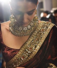 Indian Dark-Red Saree & Gold Jewelry Designed by Sabyasachi Indian Attire, Indian Wear, Indian Style, Indian Dresses, Indian Outfits, Indian Clothes, Ethnic Outfits, Desi Clothes, Sabyasachi Sarees