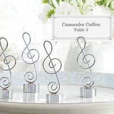 Our Love Songs Music Note Place Card Holders feature a silver finish clef note with a sturdy base and slot at the top for your place card.