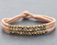 This is hand woven bracelet made with dark brown cotton waxed cord weaved together with Turquoise ,brass beads,chain and brass jingling bell. Closure using brass bell    ♥ Bracelet measures 7.5 inch long ♥ ALSO AVAILABLE IN CORAL (RED)♥    http://www.etsy.com/listing/66763806/chandelier-coral-bracelet   ♥♥You can see similar items by clicking this link♥♥  http://www.etsy.com/shop/XtraVirgin    SHIPPING :: The item shipped by Thai airmail within 1-2 days after payment received. Usually takes…