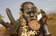 A Mursi woman with an ipod & AK