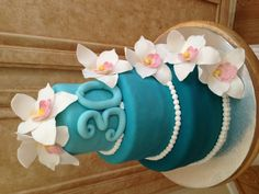 Turquoise ombré cake with orchids for a 30th birthday party www.facebook.com/cakeitorleaveitcakesbymarianne