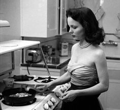 Cooking lessons with actress Wanda Hendrix, date unknown.
