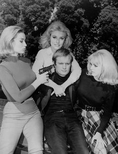 Actresses Danica D'Hondt, Sharon Tate and Kathy Kersh pose with David McCallum on the set of The Man From U.N.C.L.E.