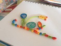 Follow these easy instructions on how to make beautiful paper quilling shapes for floral designs and patterns.
