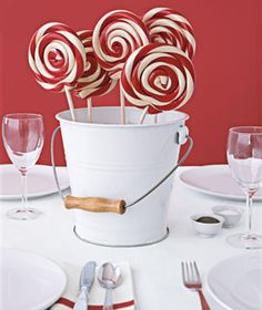 Lollipops in a bucket as a centerpiece.  Cute!