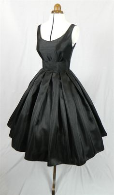 A Gorgeous Black Shantung 50s cocktail dress, fully lined and shown with a petticoat