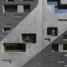 Rotterdam studio 24H architecture havecompletedthis office building in theNetherlandsthat has a solid concrete and asphalt south facade and a patterned timber north facade.