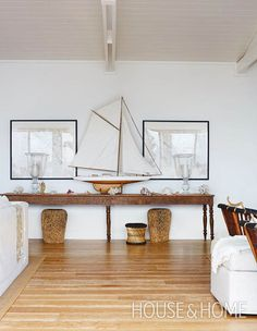 A vintage sailboat sets the stage for a beachy scene. Elevate the look with pieces of coral and shells.   Photographer: Virginia MacDonald   Designer: Montana Burnett