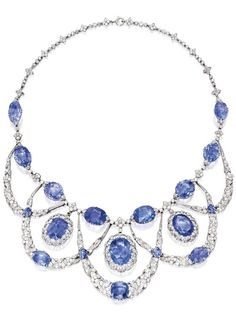 A Belle Époque Platinum, Sapphire and Diamond Necklace, France. The swag necklace of garland design, set with 18 cushion and oval-shaped sapphires, accented by old mine, old European, single and rose-cut diamonds, with French marks, circa 1910. #BelleEpoque #necklace