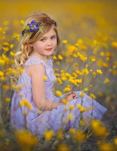 What magic a field of flowers, a child and a flower crown can produce