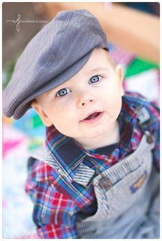 Gorgeous eyes of a little boy with a golf hat doing his One Year Old Portrait Session with Wurzbach Fisher in Fairfield California