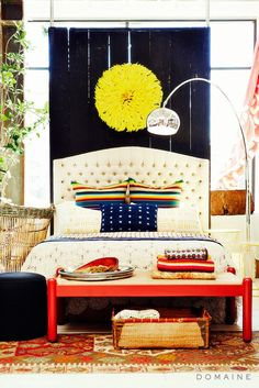 Bedroom inspiration with arc floor lamp, textiles, and primary color accents.