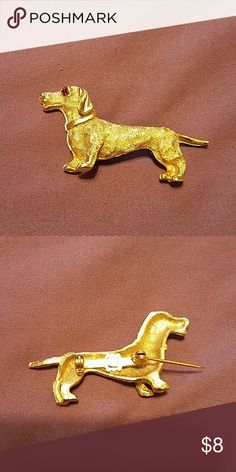 Dachshund pin Cute little vintage dachshund pin with Ruby eye. No markings on the back. Pin is 2 inches long and 1 inch high. Jewelry Brooches