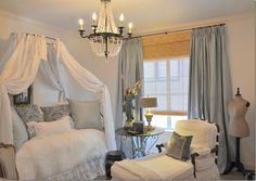 light blue drapes, chandelier, soft down filled lounge chairs, white duvet, light blue pillows, image1_thumb