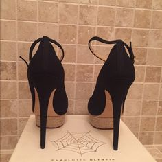 Charlotte Olympia ladies heels size 41 Brand new Super sexy and elegant Charlotte Olympia heel fabric with platform in front . Size 41 . I am a size 9 1/2 and this shoe fits me perfect because this style runs small . These are brand new Charlotte Olympia Shoes Heels