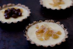 """oat-crusted tartlets with a creamy, ginger-spiked yogurt filling""......... top with candied ginger or fresh berries:)"