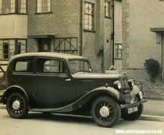 1930s   An 8hp Morris parked outside a typical 1930s semi-detached house.