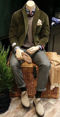 Wool trousers, sweater, striped shirt, silk tie, green corduroy jacket.