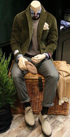 Wool trousers, sweater, striped shirt, silk tie, green corduroy jacket.