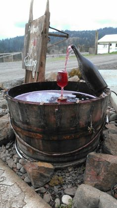 Wine bottle fountain.. now this is just CUTE!
