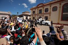 People wave to Pope Francis traveling to the Cathedral in San Cristobal de las Casas, Mexico, Monday, Feb. 15, 2016. Francis is celebrating Mexico's Indians on Monday with a visit to Chiapas state, a center of indigenous culture, where he will preside over a Mass in three native languages thanks to a new Vatican decree approving their use in liturgy. The visit is also aimed at boosting the faith in the least Catholic state in Mexico. Photo: Moises Castillo, AP / AP