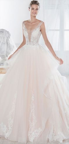 Nicole Spose 2017 Wonderful light pink princely wedding dress in tulle - Poetry and magic. Wonderful light pink princely dress in tulle enriched by beaded rebrodé lace. Perfect for the woman who desire to be the center of the attention!