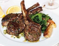 The simple rub we use on lamb chops imparts the fragrance of the Greek kitchen — that appetizing scent of garlic and dried oregano. You can use the same rub on grilled chicken. If you trim your own lamb, save the fat to tuck between cubes of lamb when you grill souvlaki. Set manners aside when you serve these ribs; to get every nugget of succulent meat, you'll need to pick the chops up.  For the Kokkari Dressing recipe.