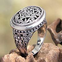 Crafted by hand, a lacy medallion depicts the ferns and flowers that flourish in Java. Kadek Hendra takes his inspiration from jasmine he observed there to create this exquisite ring.