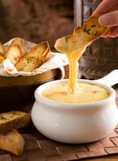 Gouda Cheese Fondue with Garlic, White Wine, Nutmeg, Tomatoes with Herbed Crostini