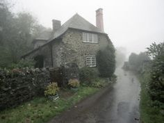 A little dream cottage at the side of a lane in the English countryside