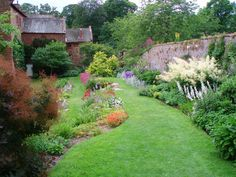 with stone wall. Acorn Bank Garden 1, Temple Sowerby, Penrith, Cumbria, England