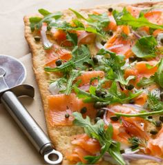 Store-bought pizza crust is the key to this dinner that looks fancy AF. Top it with cream cheese, dill, smoked salmon, arugula, and cappers. Get the recipe.